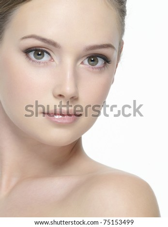 Beautiful clean face of young sexy woman looking at camera -  on  white background - stock photo