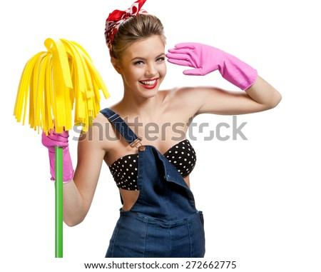 Beautiful cleaninig lady wearing pink rubber protective gloves holding cleaning mop / young beautiful American pin-up girl isolated on white background. Cleaning service concept - stock photo