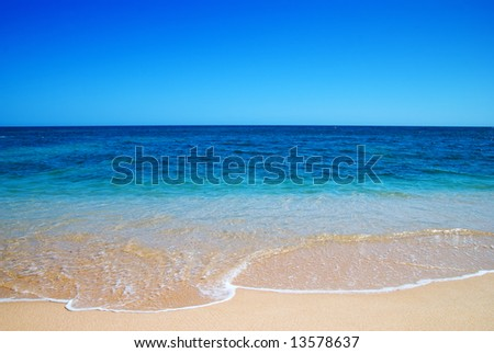 Beautiful clear mediterranean water lapping on the shore - stock photo