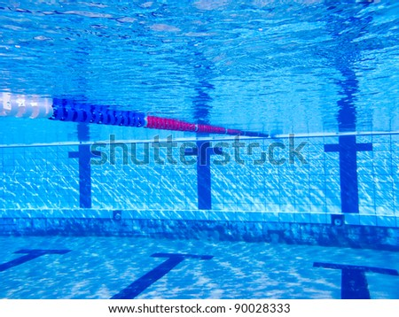 beautiful clear pool water lit by the sun - stock photo
