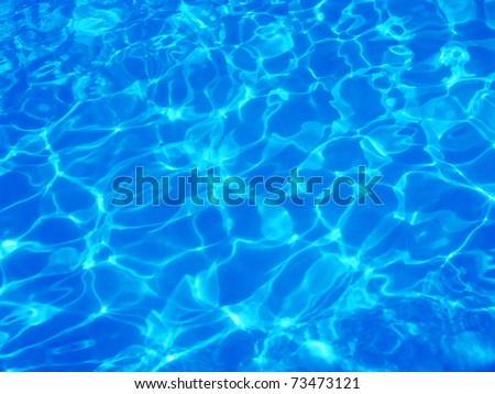 beautiful clear pool water reflecting in the sun - stock photo