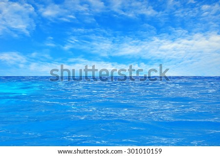 beautiful clear sea water and blue summer sky - stock photo