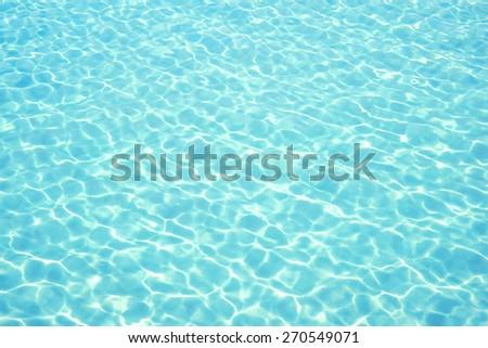 beautiful clear sea water reflecting in the sun - stock photo