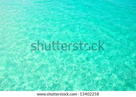 Beautiful clear turquoise ocean water with gentle ripples - stock photo