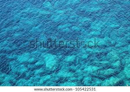 Beautiful clear, turquoise sea water, ideal for background - stock photo