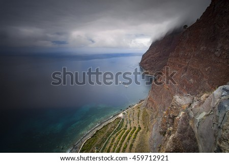 Beautiful cliff with azure water and beautiful landscape with blue sky