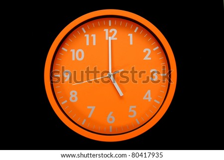 beautiful clock on the wall, 5am, 5pm - stock photo
