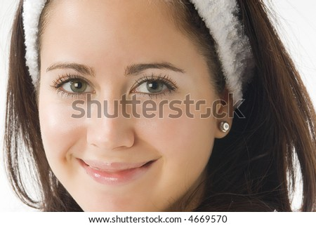 beautiful close up of a pretty girl with dark hair and fair eyes - stock photo