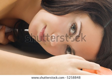 beautiful close up of a pretty girl with dark hair and fair eyes