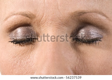 Beautiful closed female eye with makeup