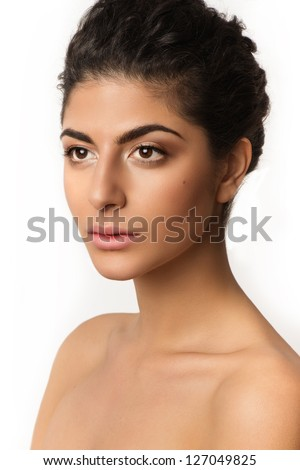 Beautiful closeup portrait of young caucasian female isolated on white background. Fresh natural makeup, big brown eyes, long lashes, gentle soft pink lipstick. Tied romantic hairstyle. - stock photo