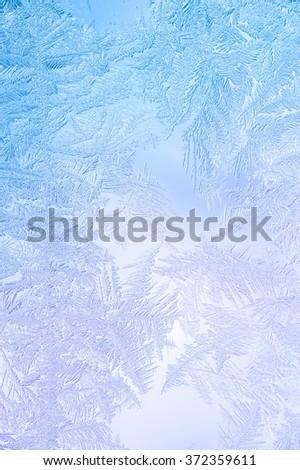 Beautiful Closeup Winter Window Pane Coated Shiny Icy Frost Patterns  - stock photo