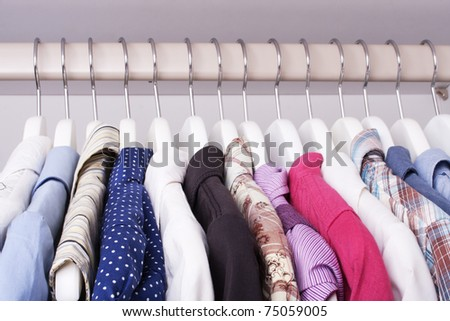 beautiful clothes in the closet on a hanger (selective focus) - stock photo
