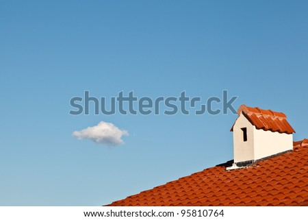 Beautiful Cloud and Dormer Window with Red Tiled Roof - stock photo
