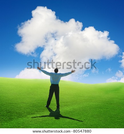 Beautiful cloud and happy young man with his hands up.Shallow DOF - stock photo