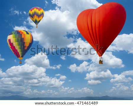 beautiful cloud scape on blue sky background over top mountain view with hot air balloons