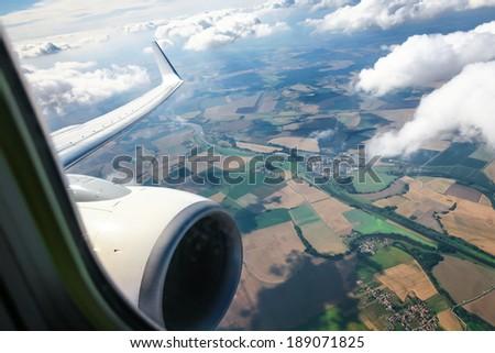 Beautiful cloud sky view from aeroplane window - stock photo