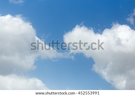 beautiful clouds against blue sky - stock photo