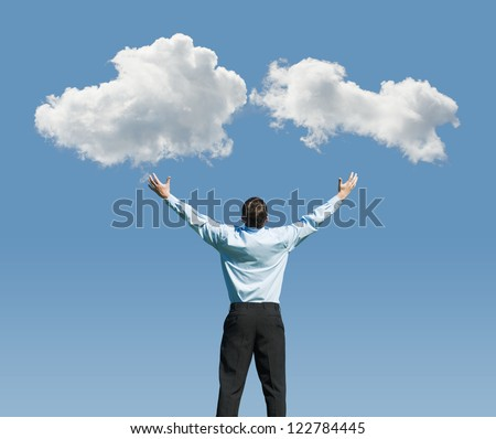 beautiful clouds and happy young man with his hands up.Concept image on cloud computing and rest - stock photo