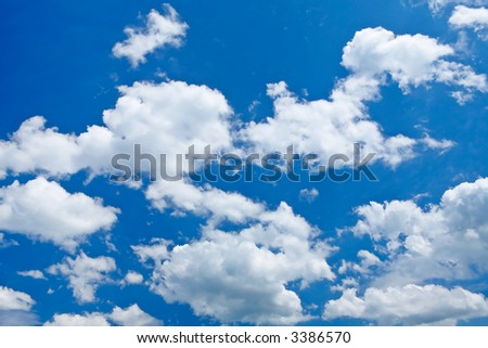 Beautiful clouds on a blue sky, just add your text - stock photo