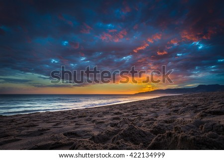 Beautiful Clouds Over the Ocean at Sunset on the Beach. - stock photo
