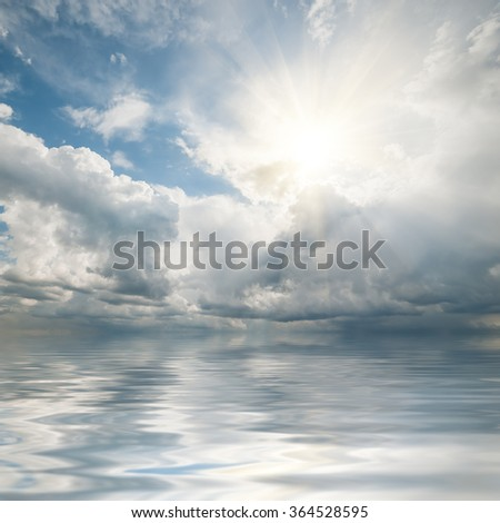 Beautiful clouds reflection in ocean, seascape, nature sky background - stock photo