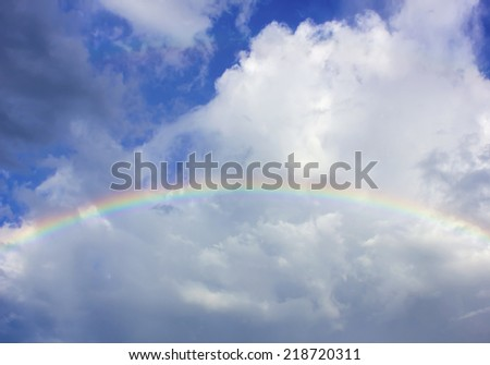 beautiful clouds with rainbow, sky background - stock photo