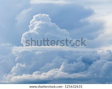 Beautiful cloudscape in blue sky background - stock photo