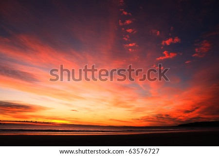 Beautiful cloudscape landscape sunset from the beach - stock photo