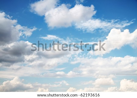 Beautiful cloudscape on bright blue sky as background