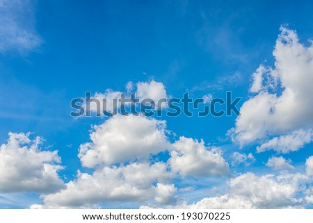 Beautiful cloudscape weather and environmental background with fluffy white cumulus clouds in a sunny blue sky with copyspace. - stock photo