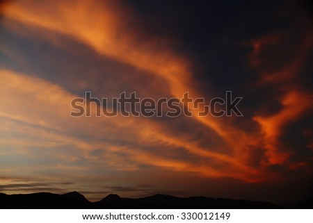Beautiful cloudscape with color lines - stock photo