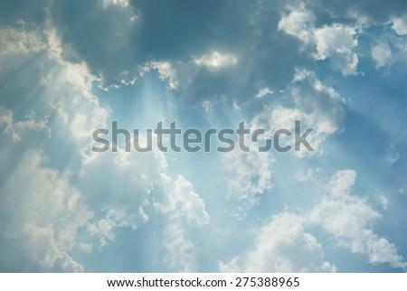 Beautiful cloudscape with sunbeams - stock photo