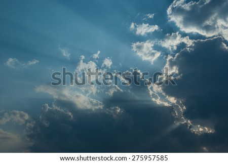 Beautiful cloudscape with sunbeams in blue sky - stock photo