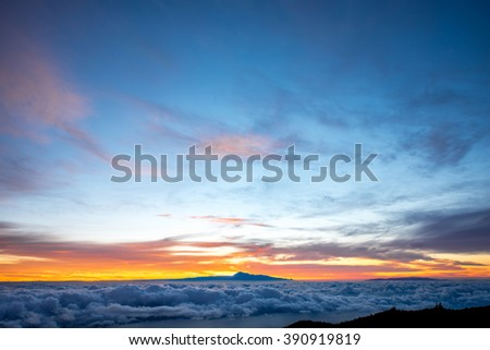 Beautiful cloudscape with Tenerife island on background on the sunrise in Spain