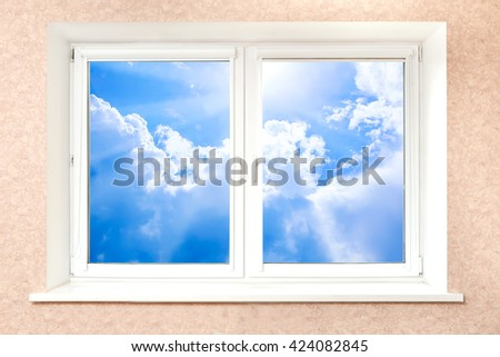 beautiful cloudy sky behind white plastic window