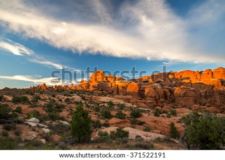 Beautiful cloudy sunset over Arches National Park in Utah, USA.
