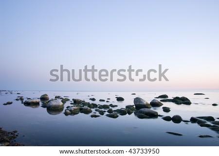Beautiful coastal sunset - stock photo