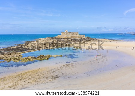 Beautiful coastline of Saint-Malo during low tide. Saint-Malo is a walled port city in Brittany (prefecture Ille-et-Vilaine) in northwestern France on English Channel.