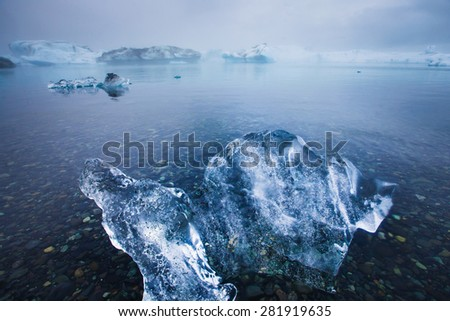 Beautiful cold landscape picture of icelandic glacier lagoon bay with ice and glacier - stock photo