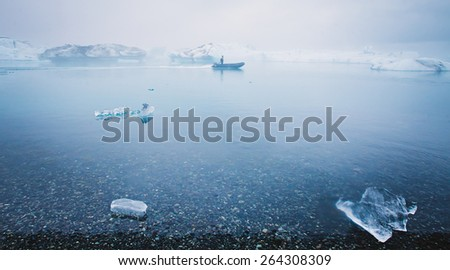 Beautiful cold landscape picture of icelandic glacier lagoon bay with ice and glacier, arctic landscape, antarctic landscape with melting glaciers, frozen lake, greenland - stock photo