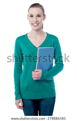 Beautiful collage girl holding spiral notebook - stock photo