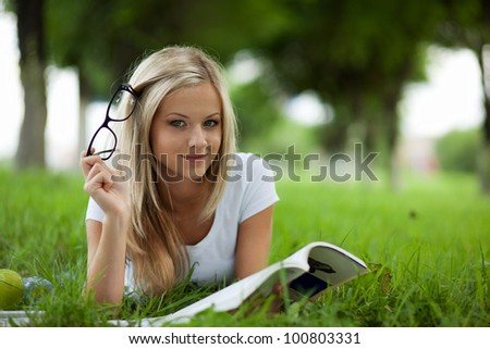 Beautiful college student relaxing in park