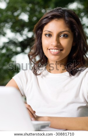 beautiful college student smiling - stock photo