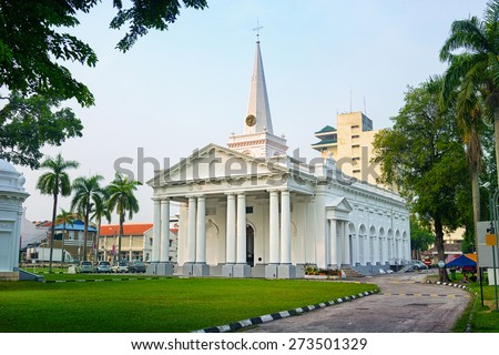 Beautiful colonial architecture of St.George's Church with it's columns, clock and steeple. - stock photo