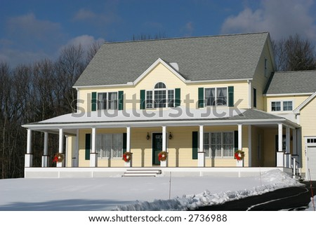 beautiful colonial home in winter - stock photo