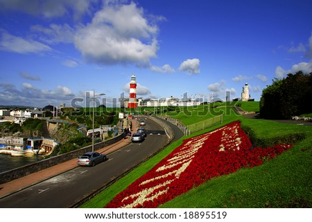 beautiful colonnade with the lighthouse, Plymouth, UK - stock photo