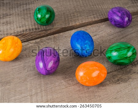 Beautiful colored easter eggs on a wooden table  - stock photo