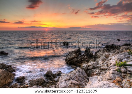 Beautiful colored sunset at the untamed shores of Pag, Croatia. HDR - stock photo
