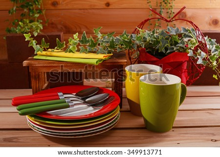 Beautiful colored Tableware on the dining table - stock photo